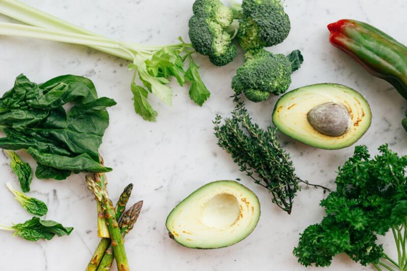 sliced-avocado-fruit-and-green-vegetable-on-white-chopping-4117545-scaled.jpg